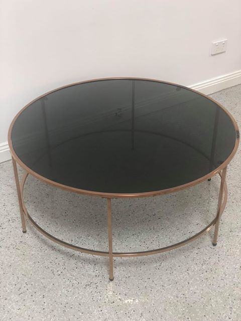 glass coffee table in tinted black